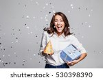 beautiful happy woman with gift ... | Shutterstock . vector #530398390