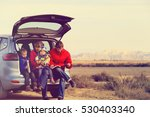 Family With Two Kids Travel By...