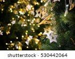 Star Hanging On Christmas Tree...