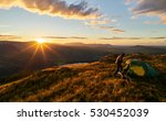 a hiker camping on the mountain ... | Shutterstock . vector #530452039