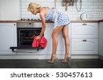 attractive girl cooking on her... | Shutterstock . vector #530457613