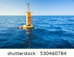 Yellow Sea Buoy In Blue Sea At...