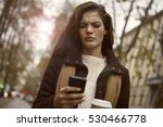Small photo of Girl looking angry at the phone