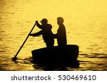 Silhouette Of Two Men Rowing I...