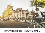 Stock photo berlin urban city life with famous reichstag building in the background in beautiful golden evening 530483950