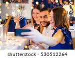 friends celebrating christmas...   Shutterstock . vector #530512264