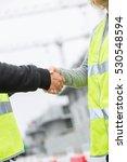 construction workers shaking... | Shutterstock . vector #530548594