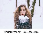 Woman Warmly Clothed In A Cold...