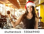 Young Woman In Santa Hat...
