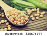 dry yellow peas in spoon with... | Shutterstock . vector #530676994