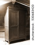 Small photo of old wooden cabinet in a dusty attic of the house