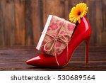 present box near shoe. flower ...   Shutterstock . vector #530689564