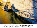 shadows by the river  | Shutterstock . vector #530703820