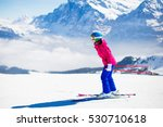 Young Active Woman Skiing In...