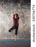 man doing yoga exercises.... | Shutterstock . vector #530746774