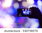 hand with a smartphone records... | Shutterstock . vector #530758570