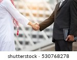 arab businessmen's handshake... | Shutterstock . vector #530768278
