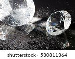 Small photo of clear crystal with water drops on black background