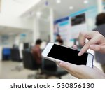 woman using touch screen mobile ... | Shutterstock . vector #530856130