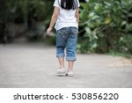 woman jeans and sneaker shoes | Shutterstock . vector #530856220
