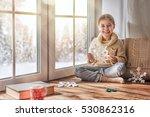 cute little girl sitting by the ... | Shutterstock . vector #530862316