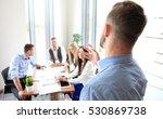 businessman giving a... | Shutterstock . vector #530869738