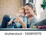 mom and toddler taking selfie... | Shutterstock . vector #530895970