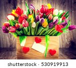 tulips in the box on wooden... | Shutterstock . vector #530919913