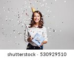 beautiful happy woman with gift ... | Shutterstock . vector #530929510