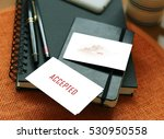 Small photo of Accepted words written on wooden table with diary and pen