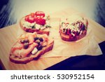 Three Bruschettas On Wooden...