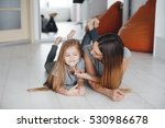 mother with daughter having fun ... | Shutterstock . vector #530986678