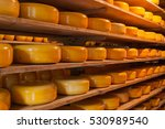 Dutch Cheeses On Wooden Layers