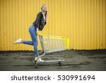 woman in the supermarket with... | Shutterstock . vector #530991694
