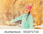 Girl Having Fun Time With Snow...