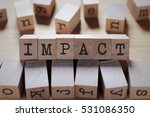 Impact Word In Wooden Cube