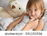 small sick girl taking medicine | Shutterstock . vector #531152536