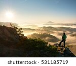 man silhouette stay on sharp... | Shutterstock . vector #531185719