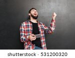 cheerful bearded young man... | Shutterstock . vector #531200320