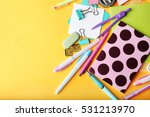 Colorful stationery on yellow...