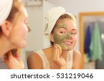 woman removing facial dried...   Shutterstock . vector #531219046