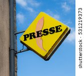 Small photo of LA SOUTERRAINE, FRANCE - JULY 25, 2016: Typical, well known sign for a presse shop or newsagent in France on July 25, 2016 in La Souterraine, France.