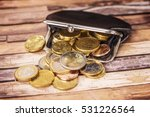 open wallet with many euro coins | Shutterstock . vector #531226564