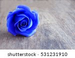 Beautiful Blue Rose On Wooden...