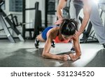trainer assisting a muscular... | Shutterstock . vector #531234520