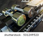 row of heavy dumbbells in sport ... | Shutterstock . vector #531249523