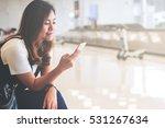 a beautiful asian woman using... | Shutterstock . vector #531267634