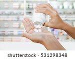 Hand Of Doctor Holding Medicin...