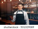 male waiter holding tray in cafe | Shutterstock . vector #531329089