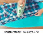 closeup of woman ironing... | Shutterstock . vector #531396670